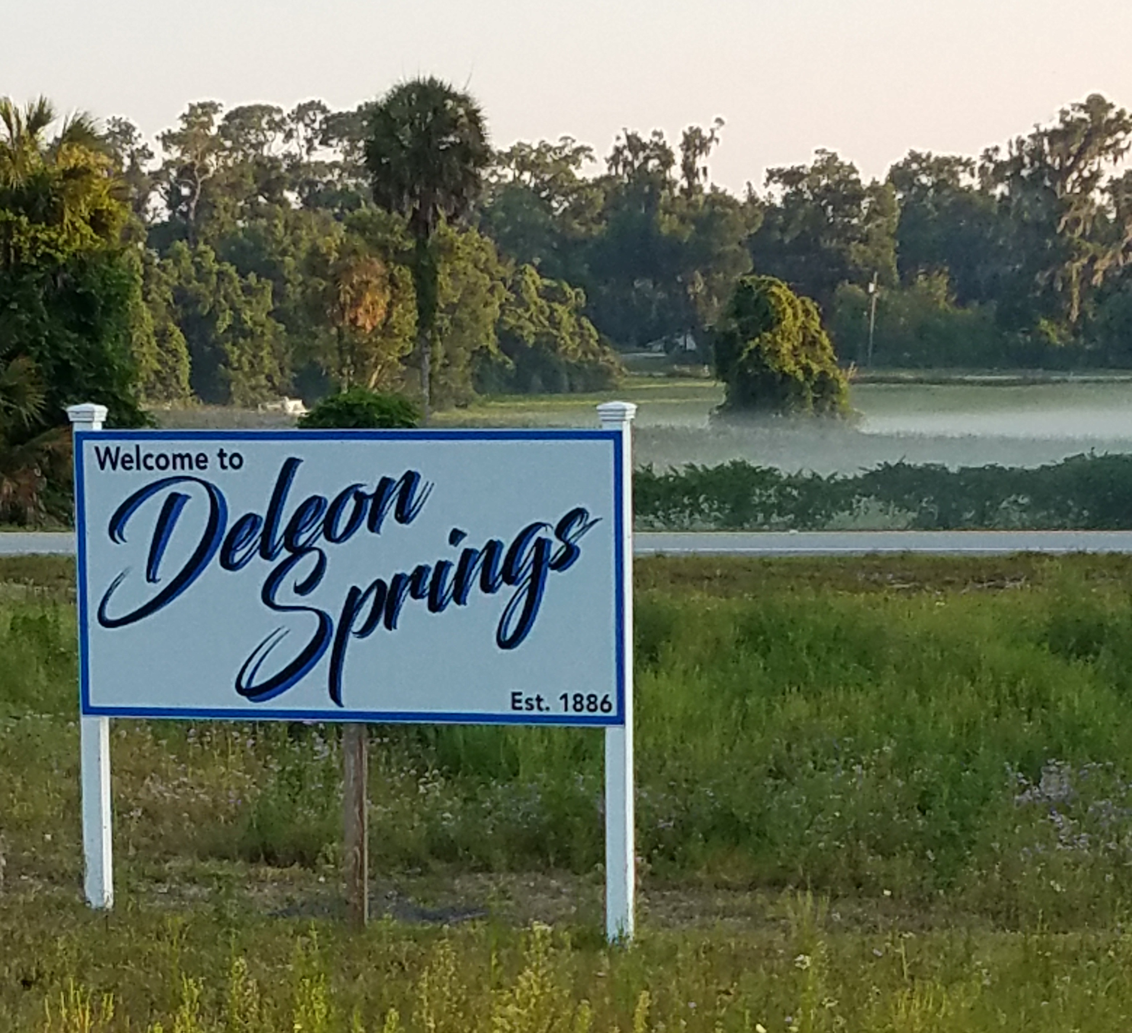 Sign reading Welcome to DeLeon Springs