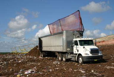 Image of semi truck dumping debris from the Transfer Station at the Landfill