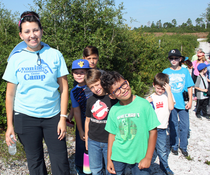 Photo of volunteer with children in Lyonia Preserve
