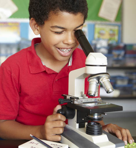 Photo of boy with microscope