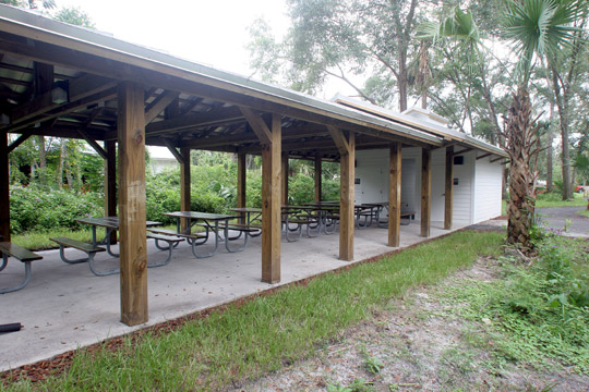 covered pavilion with several picnic tables