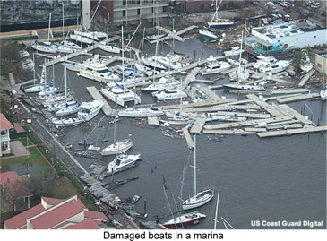 damaged boats in a marina
