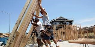 Men raising new wall of home
